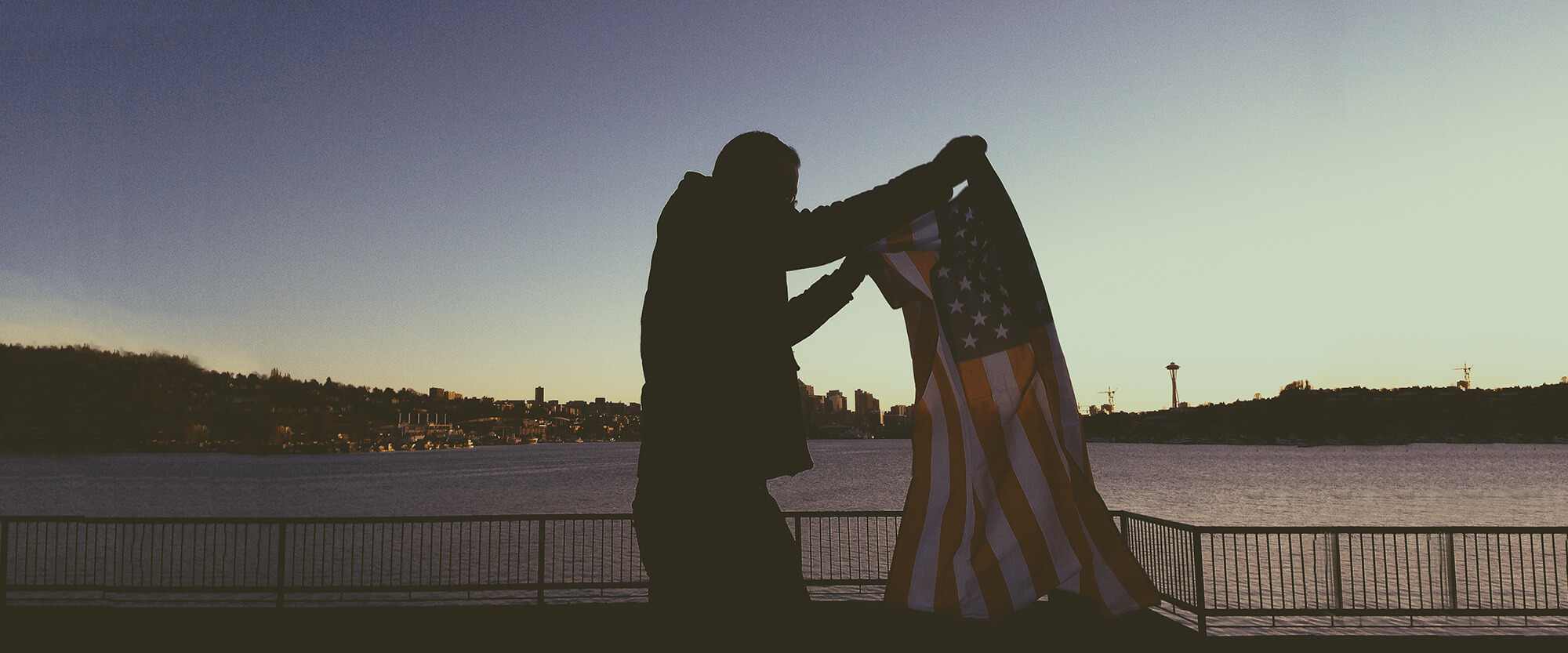 Man Holding US Flag
